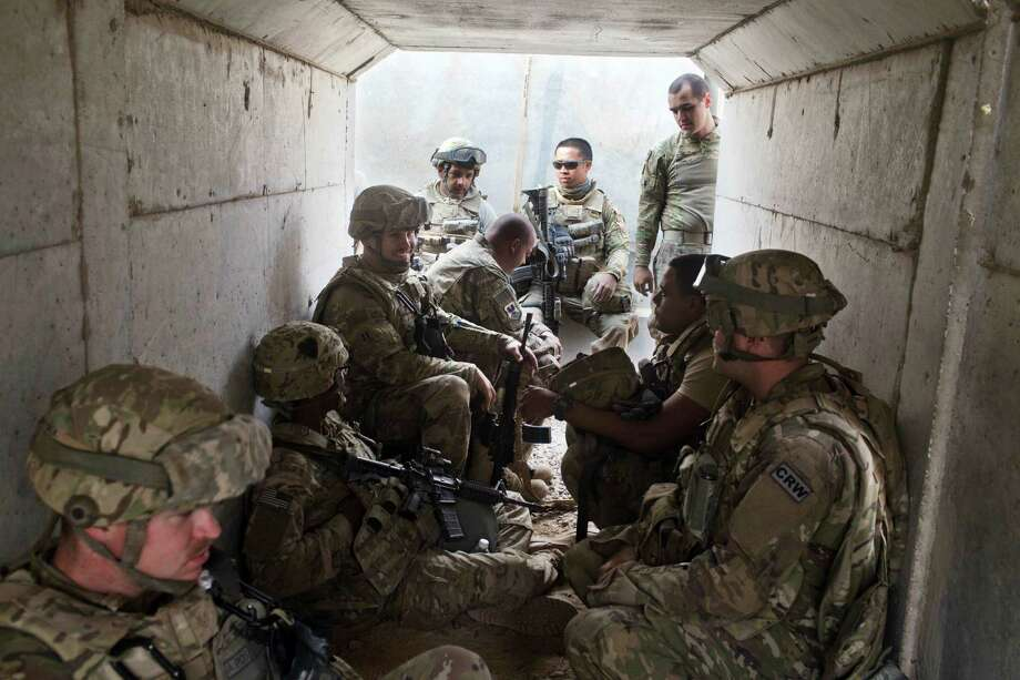 U.S. military personnel wait in a bunker Friday as an incoming mortar alarm is called at a coalition air base in Qayara, some 50 kilometers south of Mosul, Iraq. Photo: Marko Drobnjakovic, STR / Copyright 2016 The Associated Press. All rights reserved.