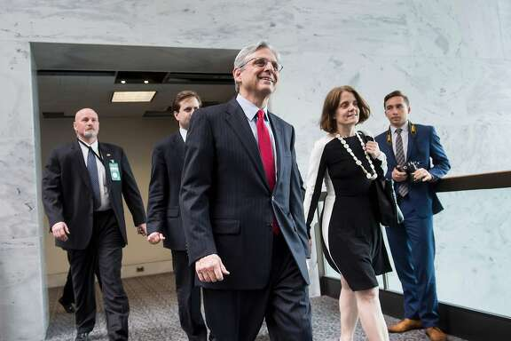US Supreme Court nominee Judge Merrick Garland walks others to a meeting with Sen. Brian E. Schatz (D-HI) on Capitol Hill May 10, 2016 in Washington, DC. / AFP PHOTO / Brendan SmialowskiBRENDAN SMIALOWSKI/AFP/Getty Images