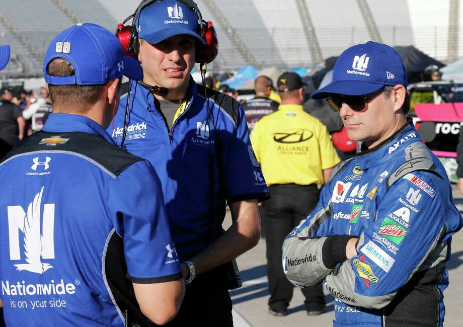 NASCAR Sprint Cup driver Jeff Gordon, right, talks to his crew as he waits for qualifying at the Martinsville Speedway in Martinsville, Va., Friday, Oct. 28, 2016. Gordon is driving the No. 88 car for the injured Dale Earnhardt Jr. (AP Photo/Steve Helber) ORG XMIT: VASH104 Photo: Steve Helber / Copyright 2016 The Associated Press. All rights reserved.