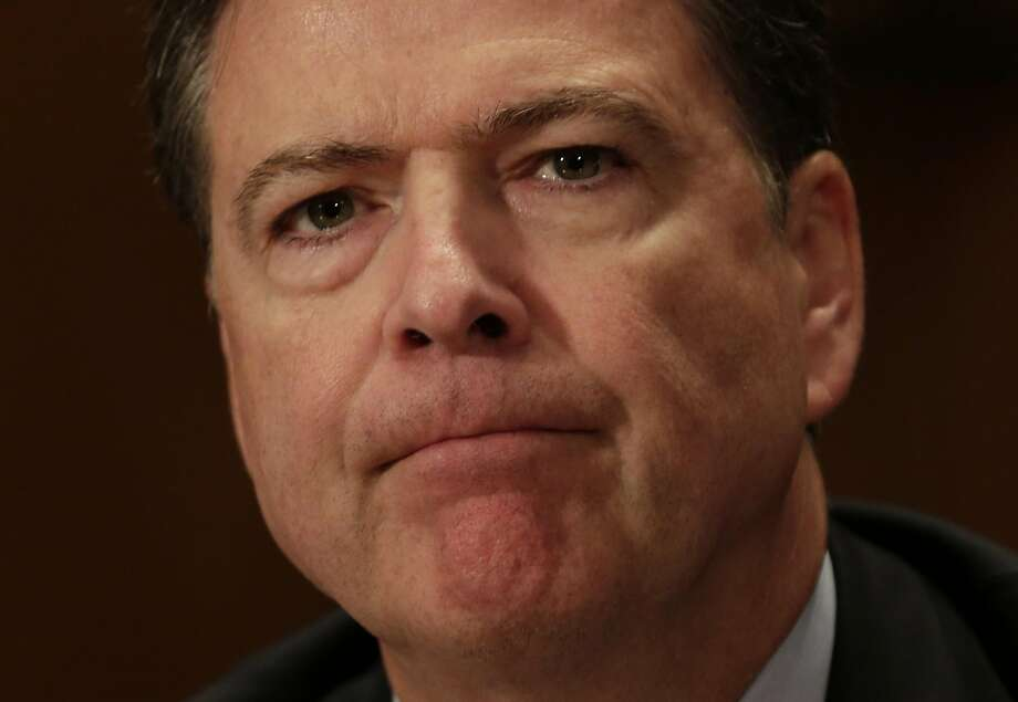 """(FILES) This file photo taken on September 27, 2016 shows FBI Director James Comey as he testifies during a Senate Committee on Homeland Security and Government Affairs hearing  on Capitol Hill in Washington, DC.  The FBI told US lawmakers October 28, 2016 it has reopened its review of White House frontrunner Hillary Clinton's use of a personal email server when she was secretary of state, after discovering new mails """"that appear to be pertinent."""" FBI director James Comey said his agency would take """"appropriate investigative steps"""" to decide whether a new batch of mails contained classified information """"as well as to assess their importance to the investigation.""""  / AFP PHOTO / YURI GRIPASYURI GRIPAS/AFP/Getty Images Photo: YURI GRIPAS, AFP/Getty Images"""