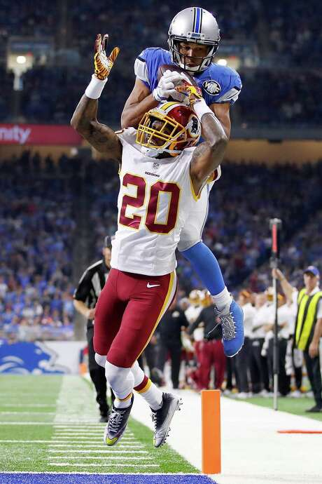 Golden Tate of Detroit, making a catch over the head of Washington's Greg Toler, is one of a trio of receivers the Lions have relied on this season. Photo: Gregory Shamus, Staff / 2016 Getty Images