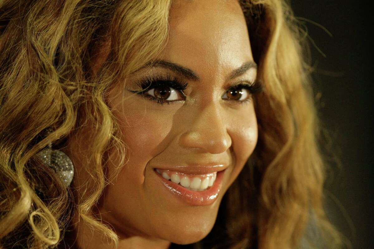 Beyonce at press conference at Toyota Center Saturday, July 4, 2009, in Houston about her patrnership with General Mill's Hamburger Helper to help fight hunger. The campaign is called Show Your Helping Hand. Food donations are collected at her concert sites. ( Melissa Phillip / Chronicle )