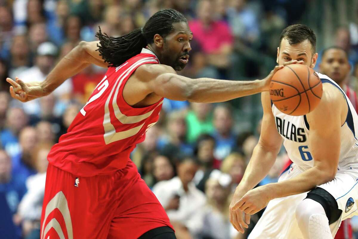 DALLAS, TX - OCTOBER 28: Nene Hilario #42 of the Houston Rockets scrambles for the ball against Andrew Bogut #6 of the Dallas Mavericks in the first half at American Airlines Center on October 28, 2016 in Dallas, Texas. NOTE TO USER: User expressly acknowledges and agrees that, by downloading and or using this photograph, User is consenting to the terms and conditions of the Getty Images License Agreement.