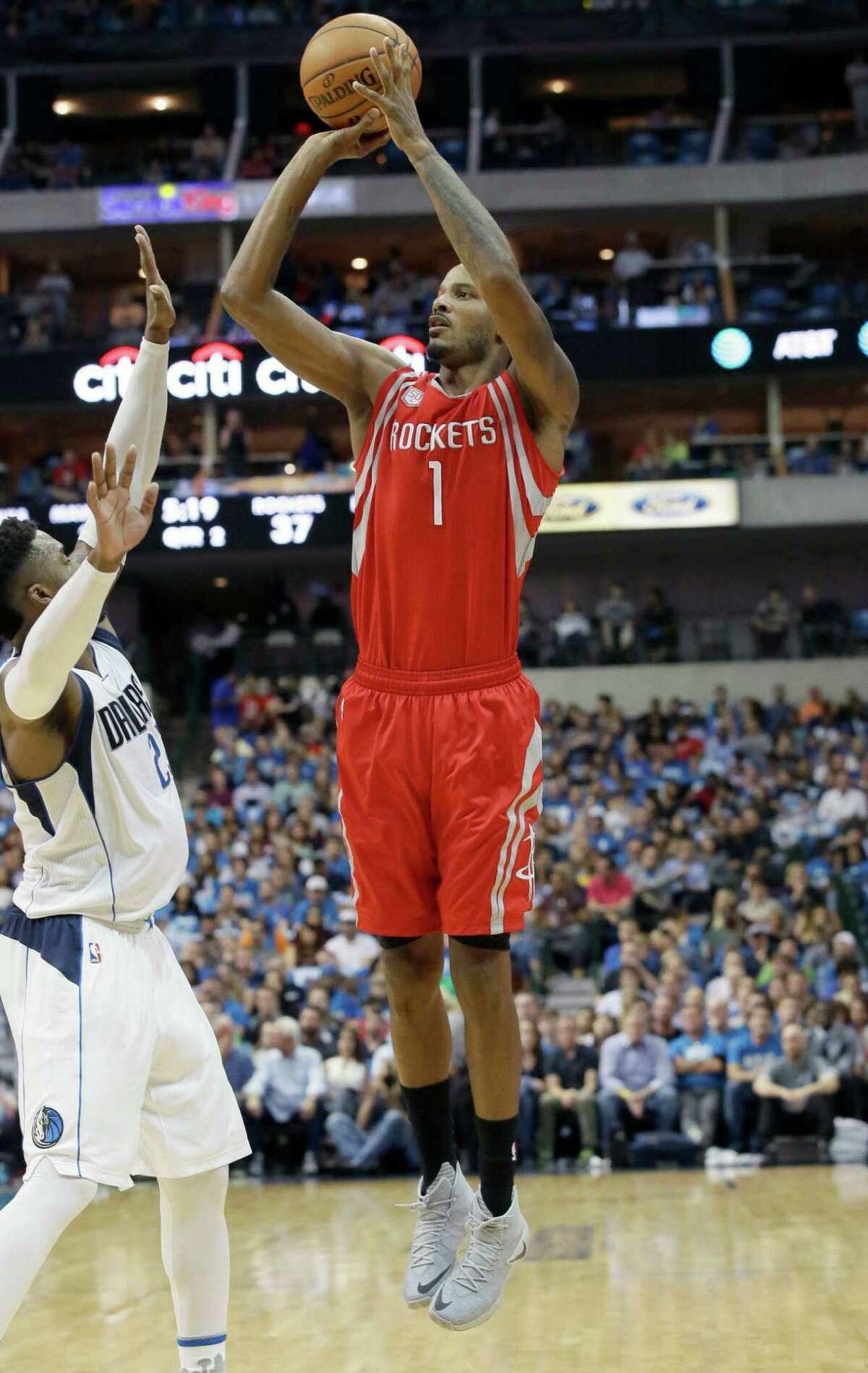 Houston Rockets forward Trevor Ariza (1) shoots over Dallas Mavericks guard Wesley Matthews (23) during the first half of an NBA basketball game in Dallas, Friday, Oct. 28, 2016. (AP Photo/LM Otero)