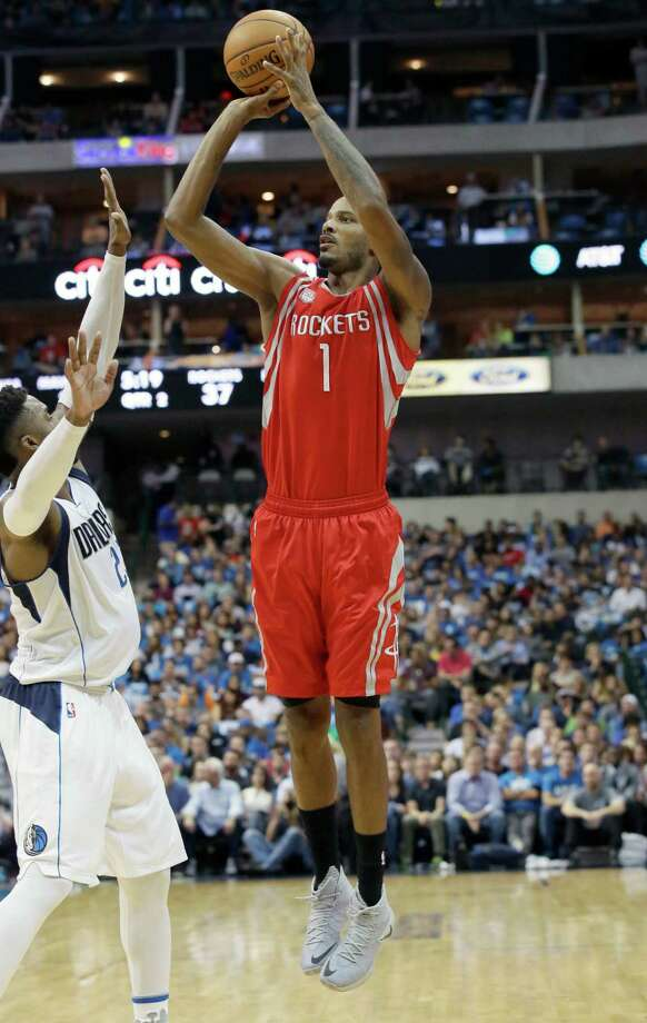 Houston Rockets forward Trevor Ariza (1) shoots over Dallas Mavericks guard Wesley Matthews (23) during the first half of an NBA basketball game in Dallas, Friday, Oct. 28, 2016. (AP Photo/LM Otero) Photo: LM Otero, Associated Press / Copyright 2016 The Associated Press. All rights reserved.