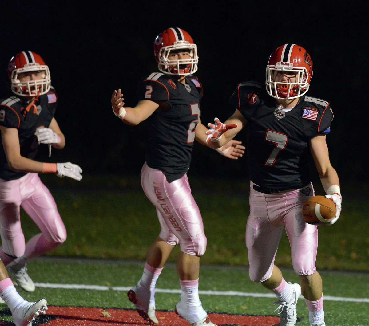 New Canaan Ryan O'Connell (7) celebrates his interception returned for a touchdown against Norwalk in a FCIAC varsity football game at New Canaan High School on Friday, Oct. 28, 2016.