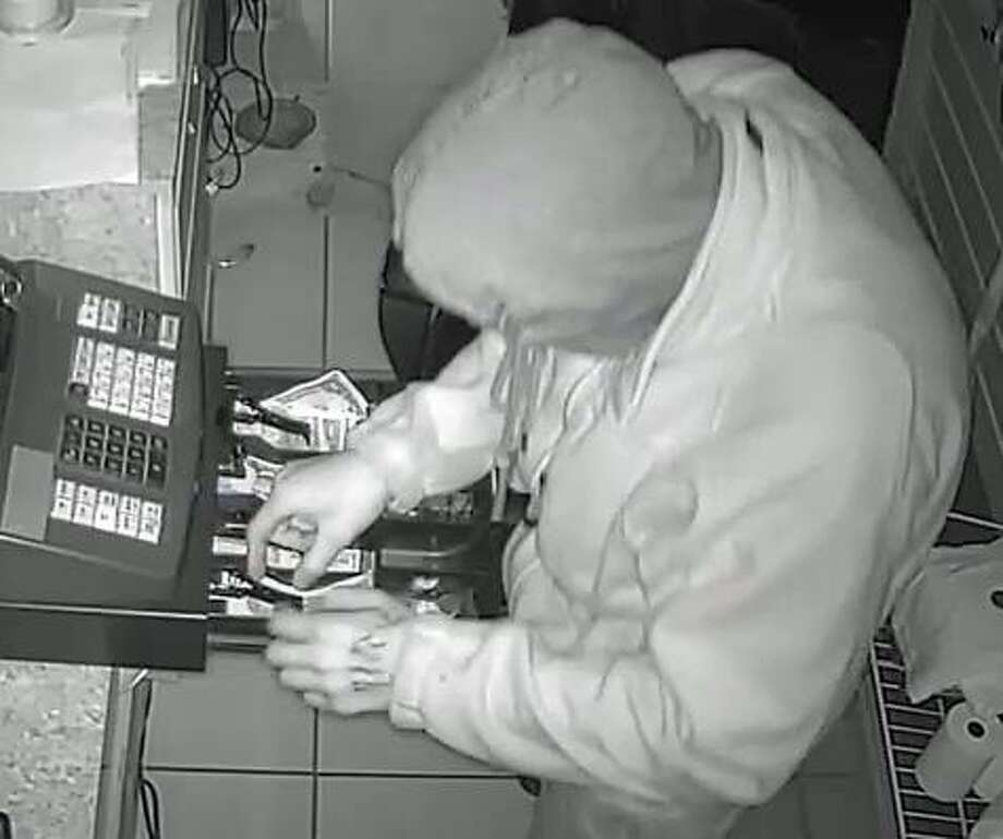 A man captured on security footage at El Mexicanito, whose owner says he and an accomplice stole $500 in a 3:00 a.m. burglary Oct. 27, 2016. Photo: Contributed Photo / Hearst Connecticut Media / Connecticut Post
