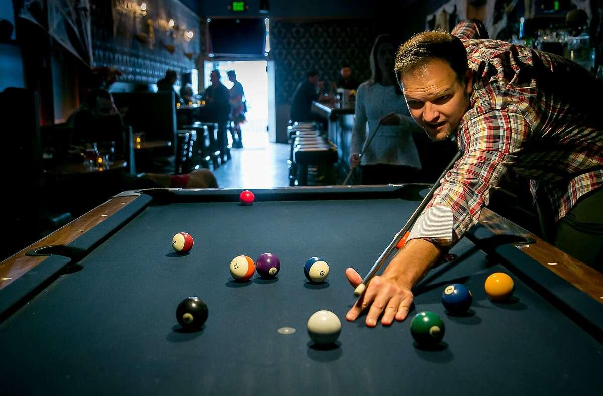 Richard Lutkus shoots pool at the Sea Star bar in San Francisco, Calif. on October 28th, 2016.