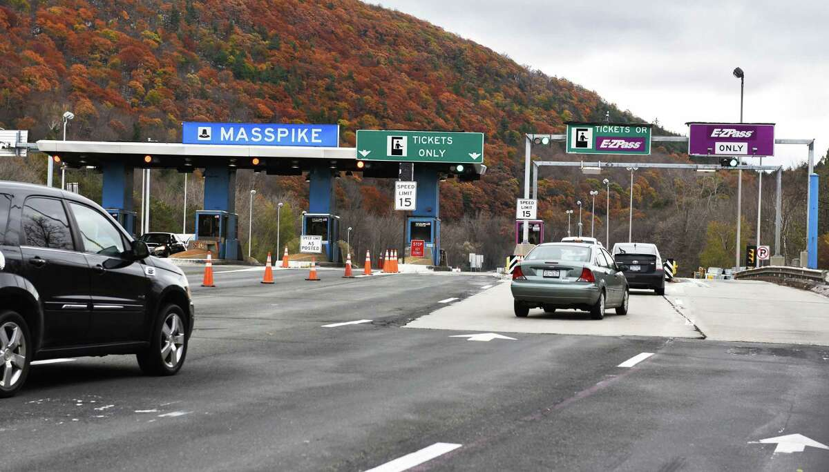 Cars enter the Massachusetts Turnpike West Stockbridge toll plaza on Friday Oct. 28, 2016, in West Stockbridge, Mass. The Massachusetts Turnpike is doing away with cash tolls and has adopted an All Electronic Tolling system. Existing toll plazas will be demolished. (John Carl D'Annibale / Times Union)