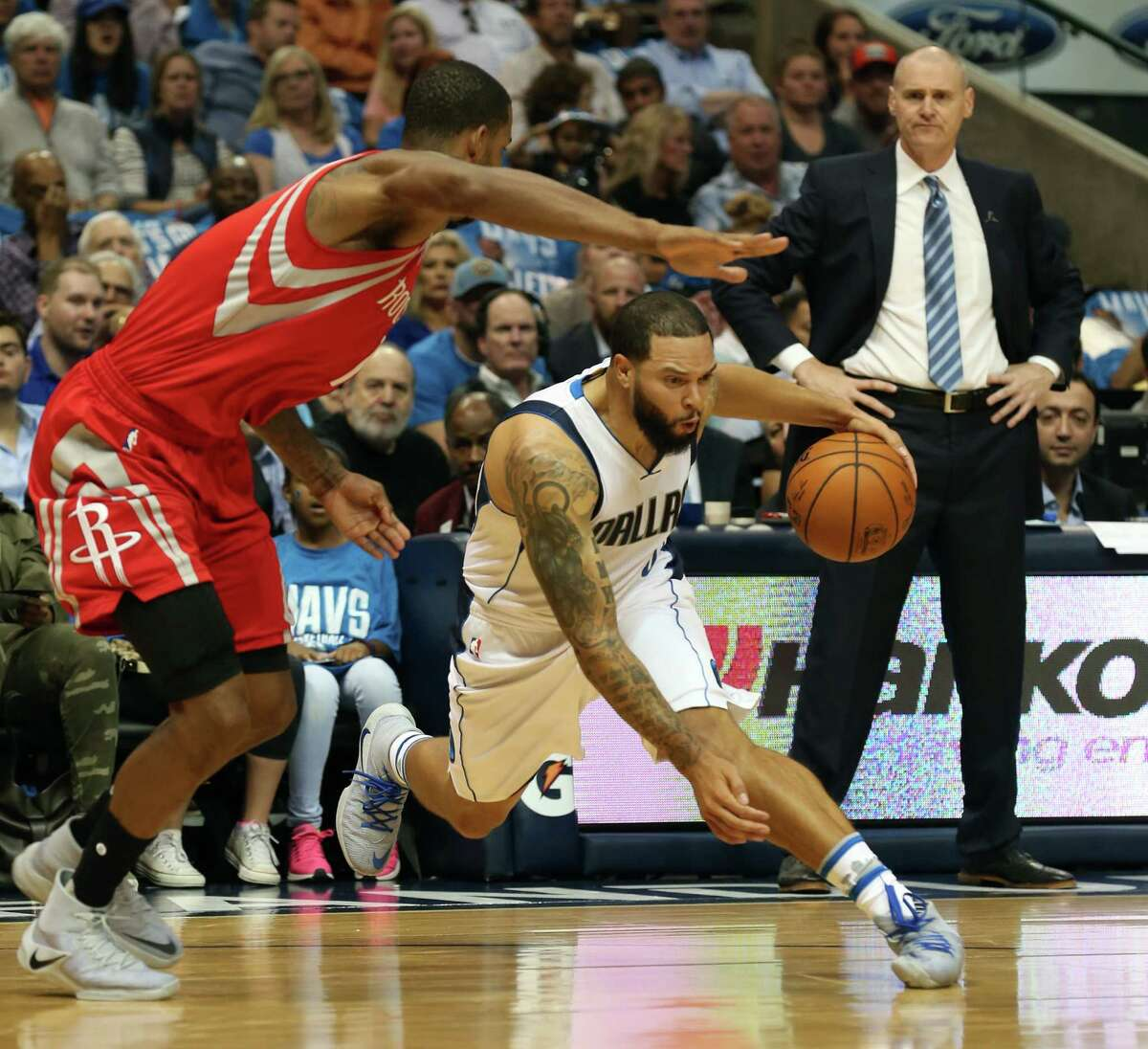The Houston Rockets' Trevor Ariza (1) defeds as the Dallas Mavericks' Deron Williams works off the dribble at American Airlines Center in Dallas on Friday, Oct. 28, 2016.
