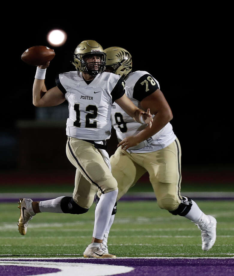 Foster's quarterback Alex Ramart (12) passes the ball during the second half of a District 27-5A high school football game between Angleton and Foster High Schools, Friday,Oct. 28, 2016 in Angleton. Photo: Karen Warren, Houston Chronicle / 2016 Houston Chronicle