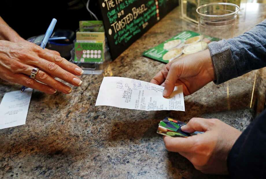 In this Wednesday, Sept. 28, 2016, photo, a customer buys lunch at Smolak Farms, in North Andover, Mass. On Friday, Oct. 28, 2016, the Commerce Department issues the first of three estimates of how the U.S. economy performed in the July-September quarter. (AP Photo/Elise Amendola) Photo: Elise Amendola, STF / AP