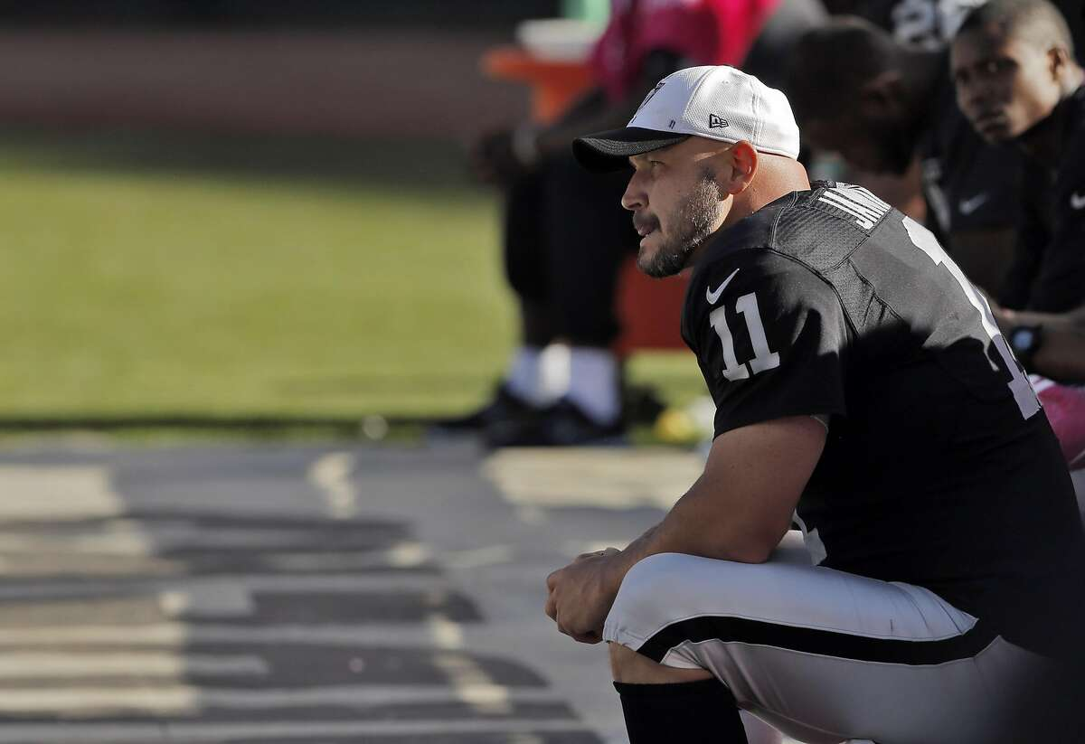 Sebastian Janikowski (11) looks out from the bench in the final minutes of the game against Denver. Janikowski has played more games for the Raiders than anyone in the team's history. The Oakland Raiders played the Denver Broncos at O.Co Coliseum in Oakland, Calif., on Sunday, October 11, 2015. The Raiders lost 16-10.