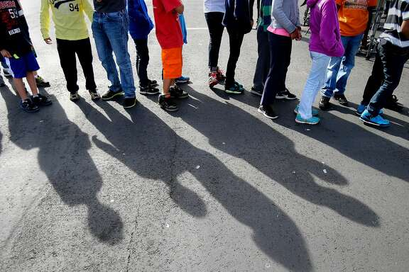 "Middle school students lined up on the playground after the drill for a speech by Mayor Lee Thursday October 16, 2014. The great California ""Shakeout"" was observed at Marina Middle School in San Francisco, Calif. with an earthquake drill for students and some public officials."