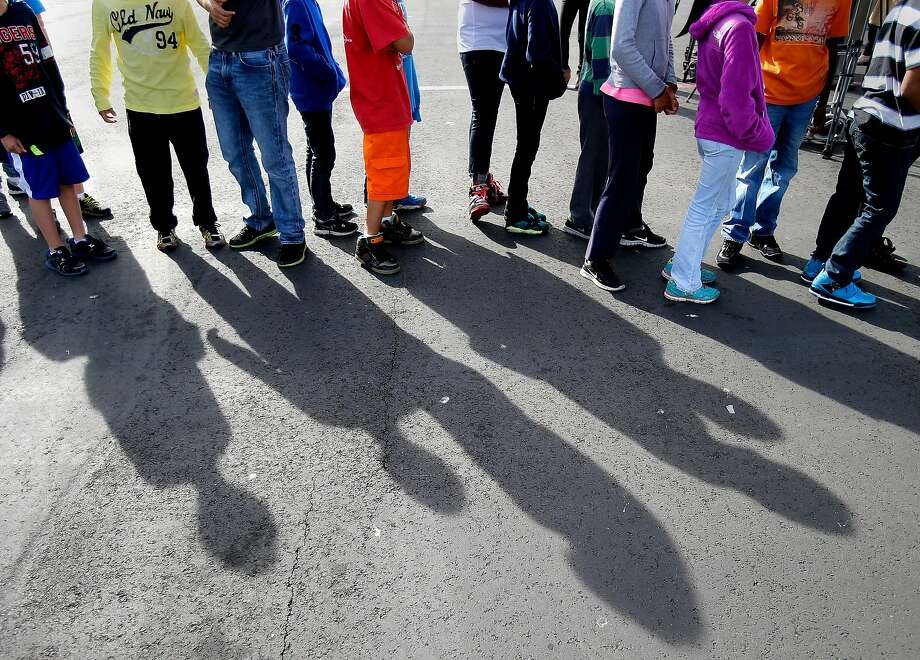 "Middle school students lined up on the playground after the drill for a speech by Mayor Lee Thursday October 16, 2014. The great California ""Shakeout"" was observed at Marina Middle School in San Francisco, Calif. with an earthquake drill for students and some public officials. Photo: Brant Ward, The Chronicle"