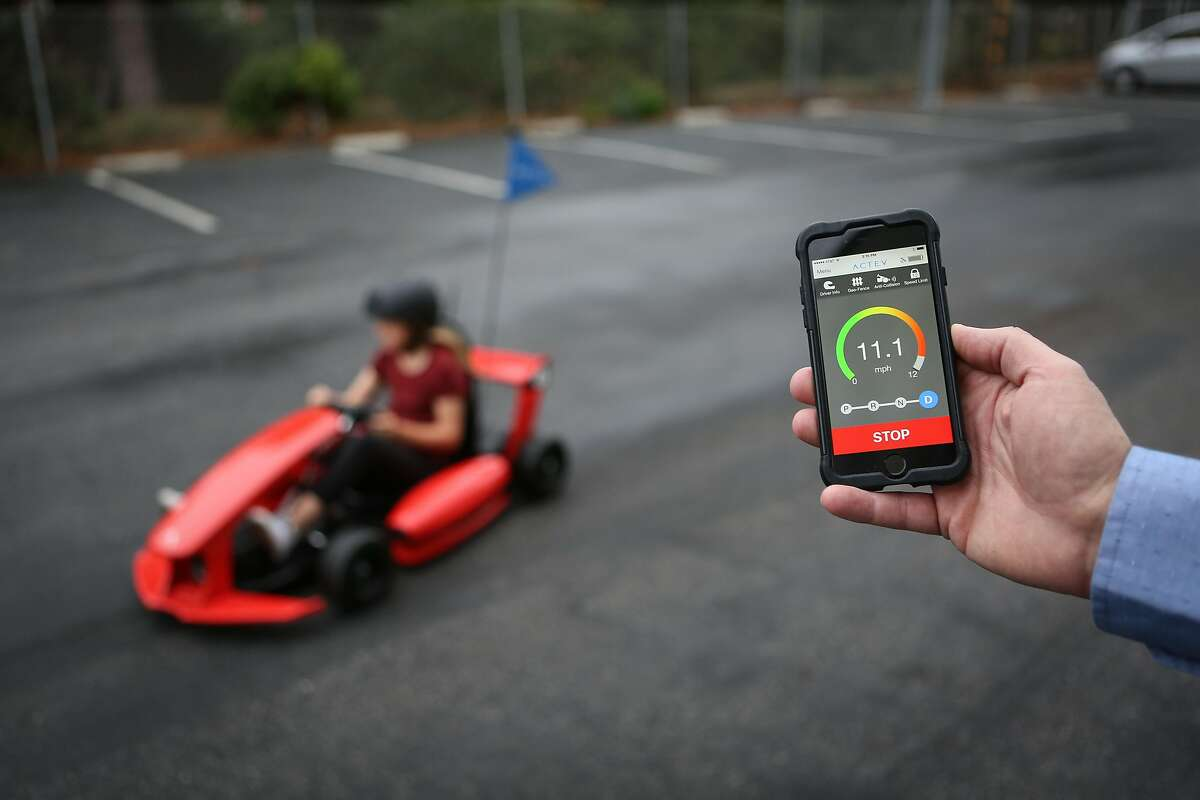 Kaylee Ellerhorst, 10, drives an Actev Motors Arrow Smart Kart in the companies parking lot as the CEO Dave Bell (not pictured) demonstrates how the app can control things such as speed in Mountain view on Thursday, Oct 27, 2016.
