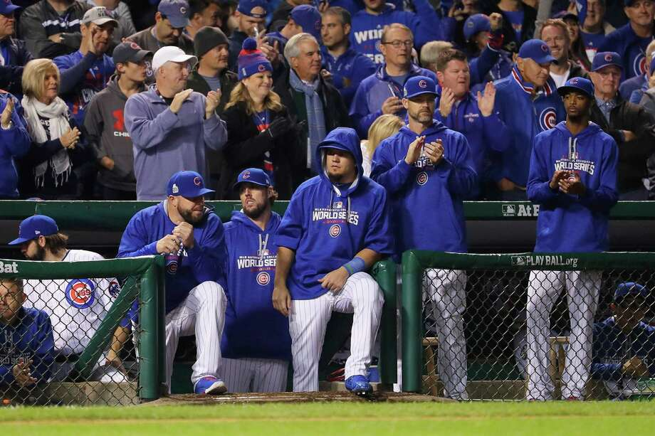 CHICAGO, IL - OCTOBER 28:  Members of the Chicago Cubs stand in the dugout in the ninth inning against the Cleveland Indians in Game Three of the 2016 World Series at Wrigley Field on October 28, 2016 in Chicago, Illinois. Photo: Jamie Squire, Getty Images / 2016 Getty Images