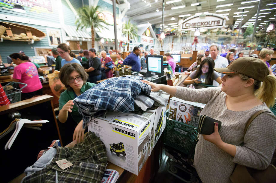 Maria Villarreal checks out during Black Friday at Bass Pro Shops, Friday, Nov. 27, 2015, in Pearland. (Cody Duty / Houston Chronicle) Photo: Cody Duty, Staff / © 2015 Houston Chronicle