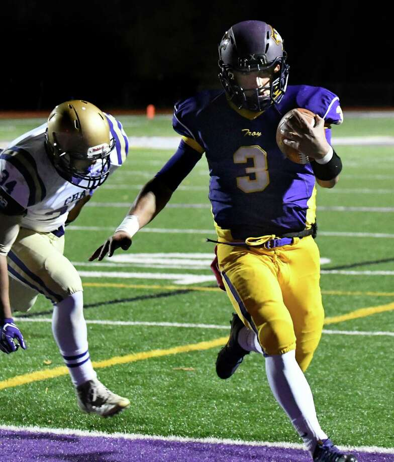 Troy quarterback John Germinerio, right, runs in for a touchdown during their Class AA semifinal football game against CBA on Friday, Oct. 28, 2016, at Troy High in Troy, N.Y. (Cindy Schultz / Times Union) Photo: Cindy Schultz / Albany Times Union