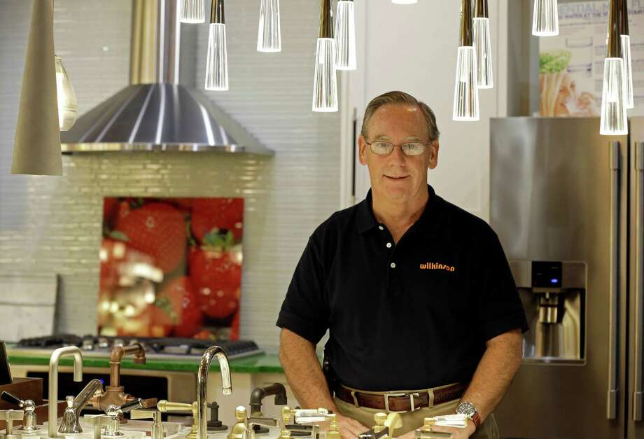 In this Friday, Oct. 21, 2016, photo, Ken Wertz, president of Wilkinson Supply, poses for a picture in the company's showroom that sells kitchen, bathroom, plumbing and decorative items, in Raleigh, N.C. Small businesses such as Wilkinson's Supply are preparing for an impending change in overtime. (AP Photo/Gerry Broome) Photo: Gerry Broome, STF / Copyright 2016 The Associated Press. All rights reserved. This material may not be published, broadcast, rewritten or redistribu