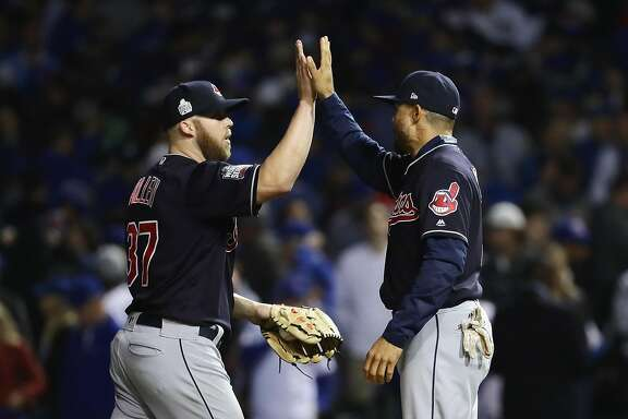CHICAGO, IL - OCTOBER 28:  Cody Allen #37 and Coco Crisp #4 of the Cleveland Indians celebrate after beating the Chicago Cubs 1-0 in Game Three of the 2016 World Series at Wrigley Field on October 28, 2016 in Chicago, Illinois.  (Photo by Jonathan Daniel/Getty Images)