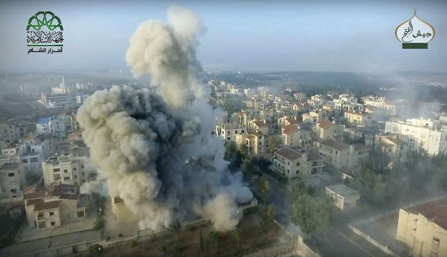 A drone image published by the Ahrar al-Sham militant group shows a bomb strike against a government-controlled neighborhood of Aleppo, Syria. Photo: Uncredited, Associated Press