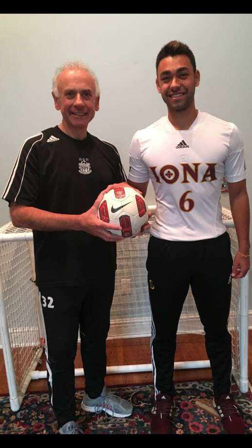 Pat Ferrandino, left, who played soccer at Brien McMahon and UConn four decades ago, poses with his son Jon-Luke Ferrandino, a former all-state player at New Canaan High and who also played at UConn before transferring to Iona College. Photo: Contributed Photo / Connecticut Post Contributed