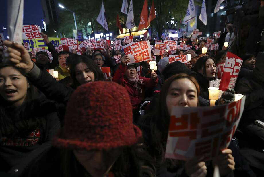 Antigovernment demonstrators march through downtown Seoul, calling for the resignation of President Park Geun-hye. Photo: Lee Jin-man, Associated Press