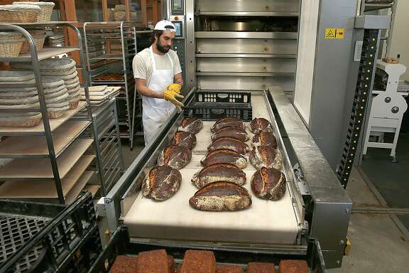 Bread comes from the oven at Tartine Manufactory on Friday, October 21, 2016,  in San Francisco, Calif.