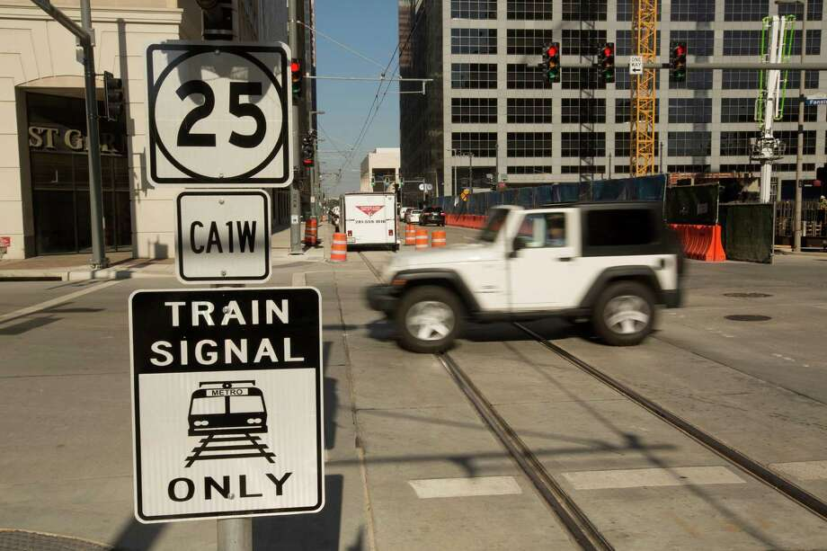 New signage near the new Green/Purple MetroRail Line station on Capitol at Fannin, seen on Oct. 22, 2014. New axle counters have already been installed in many downtown spots, but hundreds of axle counters still need to be replaced. Photo: Johnny Hanson, Staff / © 2014  Houston Chronicle