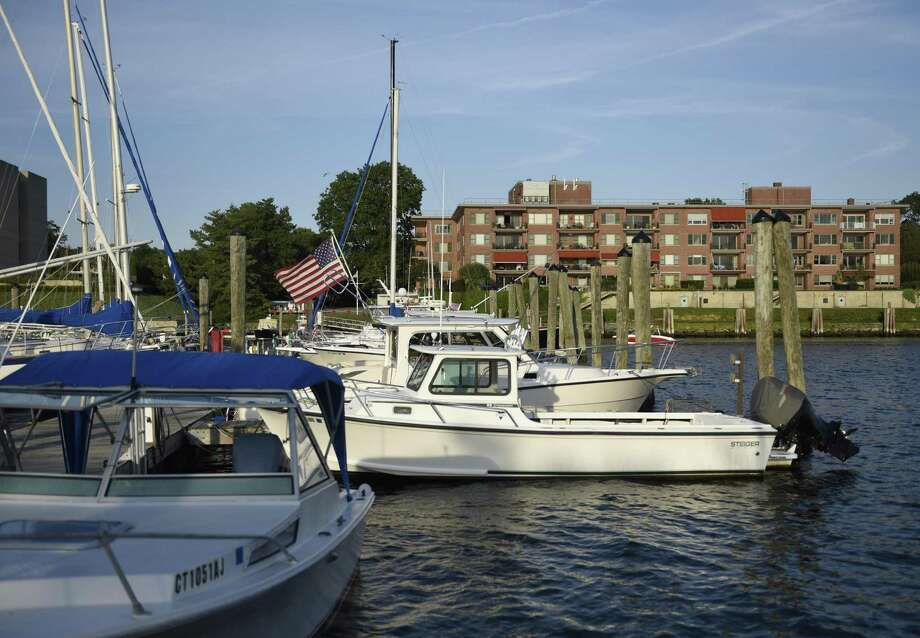 Boats are docked at the Grass Island Marina in Greenwich Harbor in Greenwich. Some members of the Harbor Management Commission are considering applying an annual fee to boat slips. Photo: Tyler Sizemore / Hearst Connecticut Media / Greenwich Time