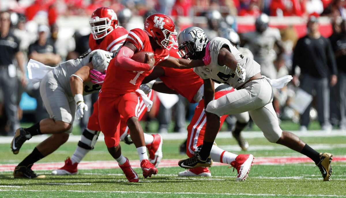 Houston Cougars quarterback Greg Ward Jr. (1) tries to shake off UCF Knights linebacker Justin McDonald (34) during the second quarter of a college football game at TDECU Stadium, Saturday,Oct. 29, 2016 in Houston.