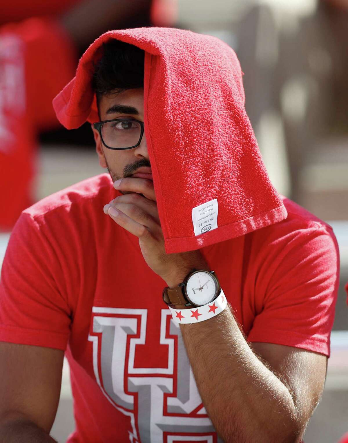 A Houston Cougars fan covers half of his face with a towel during the second quarter of a college football game at TDECU Stadium, Saturday,Oct. 29, 2016 in Houston.