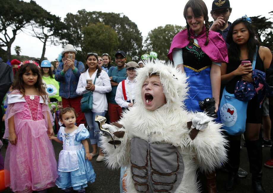 Javin Salmon roars his approval after capturing first place in the animal category for his yeti outfit in the costume parade and contest at the San Francisco Zoo's annual Boo at the Zoo Halloween celebration in San Francisco on Saturday, Oct. 29, 2016. Photo: Paul Chinn, The Chronicle