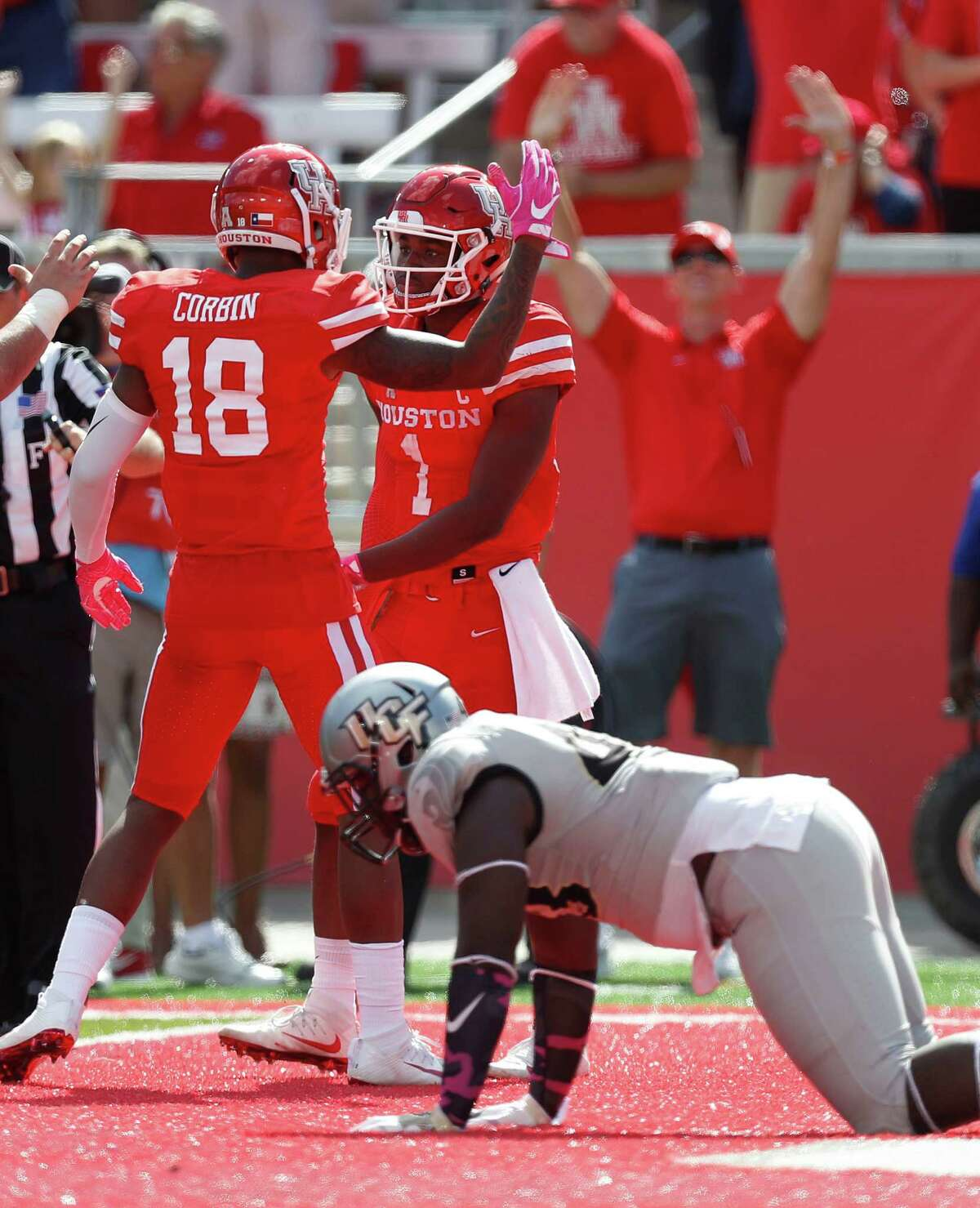 Houston Cougars quarterback Greg Ward Jr. (1) celebrates with wide receiver Keith Corbin (18) just after scoring the go-ahead touchdown against UCF Knights during the fourth quarter of a college football game at TDECU Stadium, Saturday,Oct. 29, 2016 in Houston.