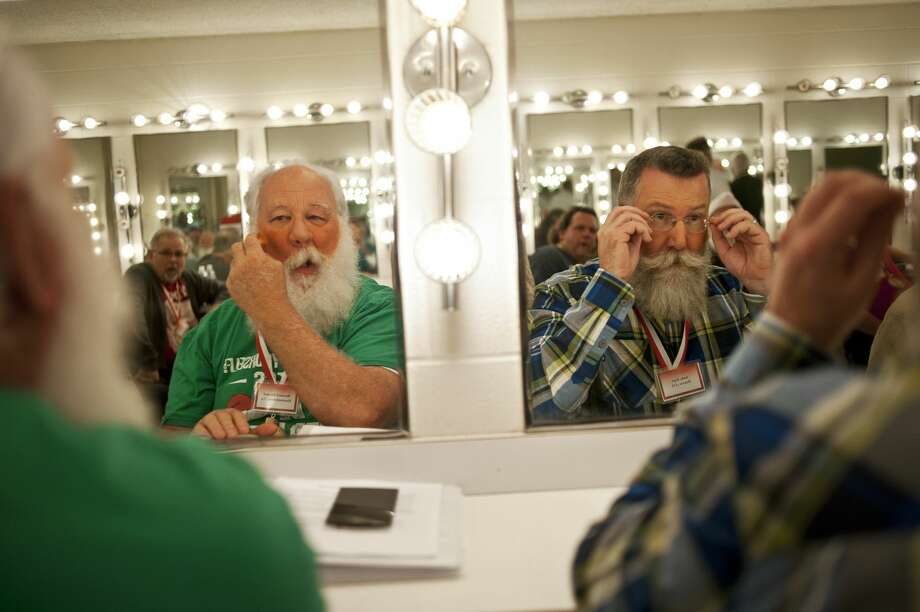 Bernard Bischof, of Hummelstown, Pa., left, and Andy Farr, of Denver, Colo., right, apply makeup during a class on Thursday at the Midland Center for the Arts during the first day of the Charles W. Howard Santa Claus School. The school is the oldest in the world and has been running for 79 years. Photo: ERIN KIRKLAND | Ekirkland@mdn.net