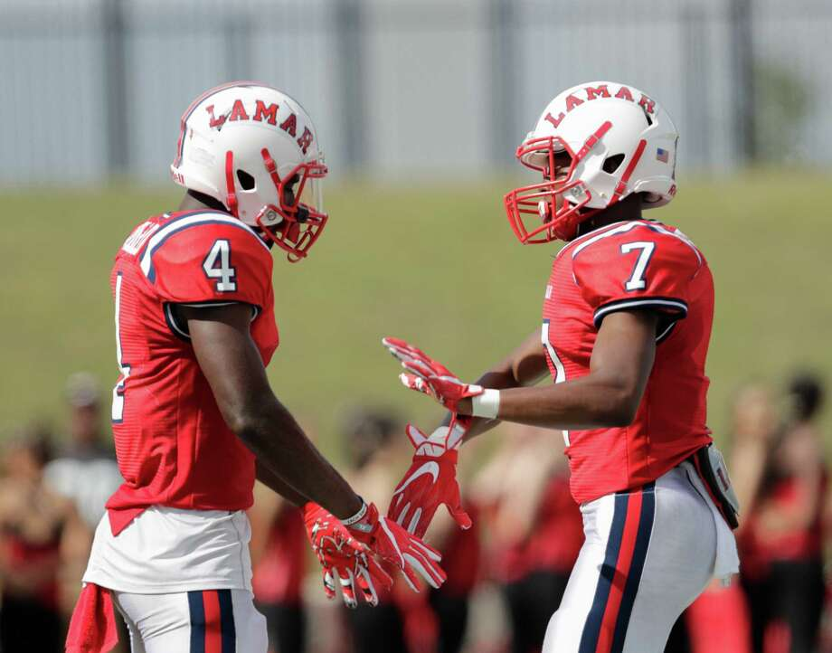 Lamar Texans wide receiver Al'vonte Woodard (4) and Lamar Texans wide receiver Ty Holden (7) celebrate after a touchdown during the high school football game between the Lamar Texans and the Bellaire Cardinals at Delmar Stadium in Houston, TX on Saturday, October 29, 2016.  The Texans lead the Cardinals 41-10 at halftime. Photo: Tim Warner, For The Chronicle / Houston Chronicle