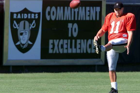 Oakland Raiders rookie kicker and top draft choice Sebastian Janikowski practices his kicking during the Raiders' training camp in Napa, Calif., Wednesday July 26, 2000.(AP Photo/Eric Risberg)