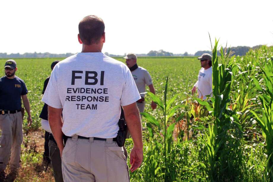 FILE – In this July 22, 2016, file photo, law enforcement officers search for missing University of Toledo student, Sierah Joughin, on James Worley's property in Delta, Ohio. The family of Joughin, who investigators say was abducted and killed by a neighbor with a hidden past, wants Ohio lawmakers to follow the lead of at least seven other states that track all sorts of violent offenders. (Cameron Hart/The Blade via AP, File) Photo: Cameron Hart, MBR / The Blade