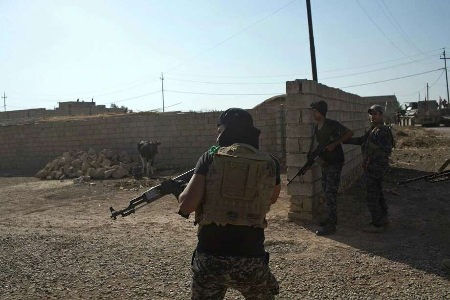 Iraqi Federal Police officers enter a compound in the town of Shura, some 30 kilometers south of Mosul, Iraq, Saturday, Oct. 29, 2016. Iraqi troops approaching Mosul from the south advanced into Shura on Saturday after a wave of US led airstrikes and artillery shelling against Islamic State positions inside town. (AP Photo/Marko Drobnjakovic) Photo: Marko Drobnjakovic, STR / Copyright 2016 The Associated Press. All rights reserved.