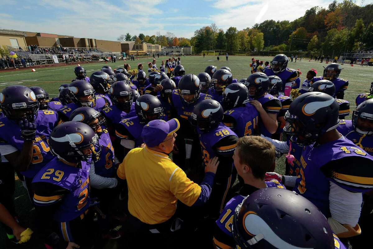 Westhill Coach Frank Marcucio rallies his players prior to an intracity football game against city rival Trinity Catholic at Westhill High School's J. Walter Kennedy Stadium in Stamford on Saturday, Oct. 29, 2016.