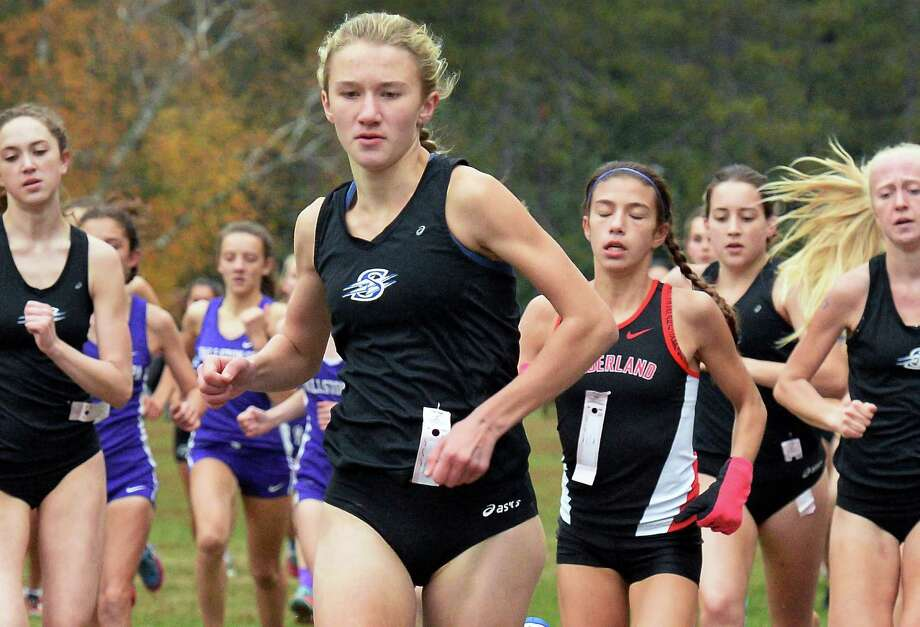 Saratoga High's Kelsey Chmiel, center, leads the pack on her way to winning Saturday's Suburban Council girl's varsity cross country championships Oct. 29, 2016 in Saratoga Springs, NY.  (John Carl D'Annibale / Times Union) Photo: John Carl D'Annibale / 20038590A