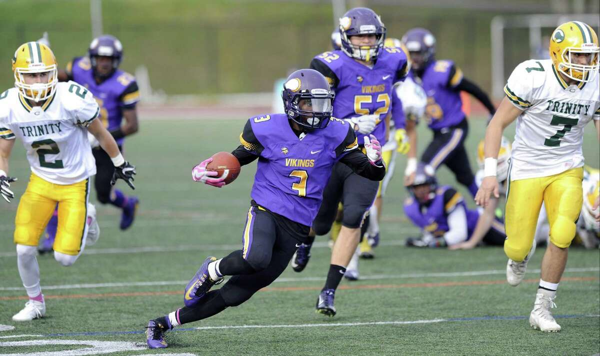 Westhill Jeremy Young (3) makes a punt return for a touchdown against Trinity in a intracity football game at Westhill High School's J. Walter Kennedy Stadium in Stamford on Saturday, Oct. 29, 2016.