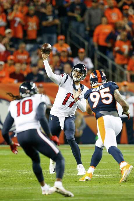 Texans quarterback Brock Osweiler, center, has been inconsistent this season, but he looks forward to the team - and himself - improving in the second half. Photo: Brett Coomer, Staff / © 2016 Houston Chronicle