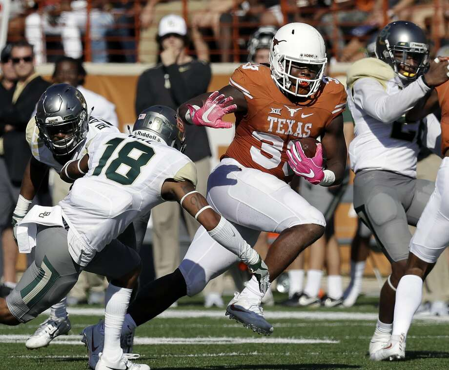 Texas running back D'Onta Foreman (33) runs past Baylor safety Chance Waz (18) during the first half on a NCAA college football game, Saturday, Oct. 29, 2016, in Austin, Texas. (AP Photo/Eric Gay) Photo: Eric Gay, Associated Press
