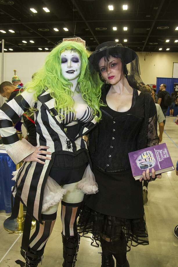 Faye Mortis (left) as Beetlejuice and Shauna Mobley as Lydia at Alamo City Comic Con, Saturday, Oct. 29, 2016. Photo: Alma E. Hernandez, For The San Antonio Express News / Alma E. Hernandez / For The San Antonio Express News