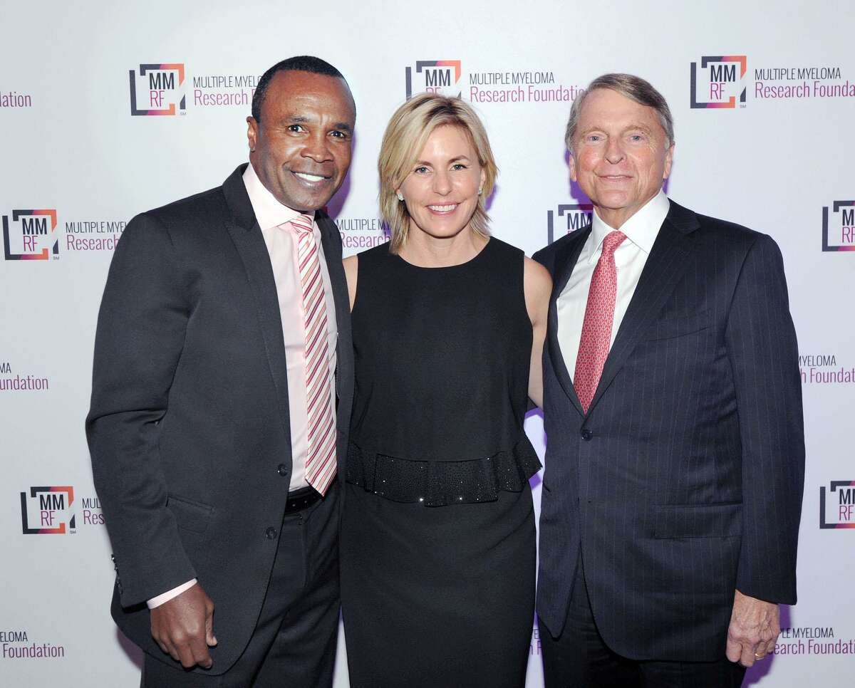 """American boxing legend Sugar Ray Leonard, left, with Anne and David Ogilvy, of Greenwich, at the Multiple Myeloma Research Foundation 2016 annual Fall Gala at Hyatt Regency Greenwich on Saturday night. The Ogilvys were honored with the Spirit of Hope Award during the event that was emceed by Leonard. Motown legend Smokey Robinson was presented with the Courage & Commitment Award. Musician Ceelo Green headlined the event. The Multiple Myeloma Research Foundation was established in 1998. MMRF is the number one private funder of multiple myeloma research and has raised $275 million since inception. """"We direct nearly 90% of our total budget to research and related programming,"""" states the organization's website."""