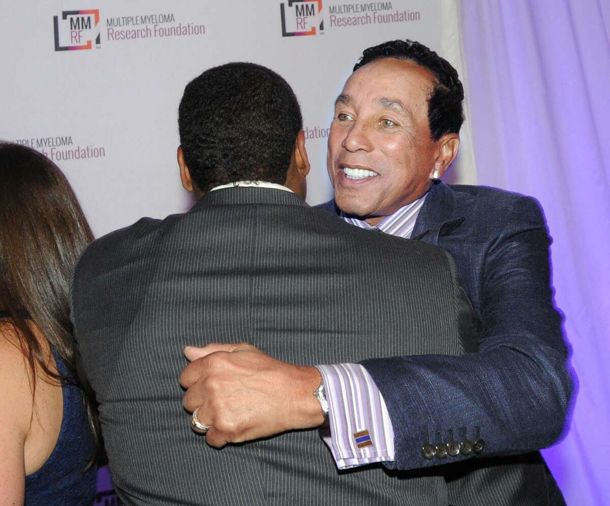 """Motown legend Smokey Robinson receives a hug Robinson was honored during the event with the Courage & Commitment Award. Anne and David Ogilvy, husband and wife of Greenwich, were also honored with the Spirit of Hope Award during the event. American boxing legend Sugar Ray Leonard was the MC for the evening. Musician Ceelo Green headlined the event. The Multiple Myeloma Research Foundation (MMRF) was established in 1998. MMRF is the number one private funder of multiple myeloma research and has raised $275 million since inception. """"We direct nearly 90% of our total budget to research and related programming,"""" states the organization's website."""