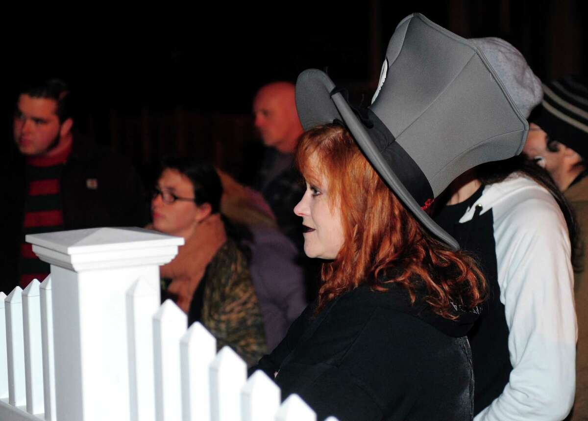 Heather Jones, of Stratford, takes part in the Haunted Lantern Tour which started on the historic Derby Green in downtown Derby, Conn., on Saturday Oct. 29, 2016. People gathered for the tour which stopped at 11 historic and allegedly haunted spots around Derby withing walking distance of the green. Money raised through the tour is going towards the restoration of the historic Sterling Opera House.