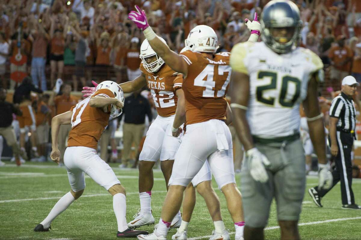AUSTIN, TX - OCTOBER 29: Trent Domingue #17 of the Texas Longhorns celebrates with teammates after kicking a field goal to put the Longhorns ahead 35-34 against the Baylor Bears with 46 seconds remaining in the second half on October 29, 2016 at Darrell K Royal-Texas Memorial Stadium in Austin, Texas.